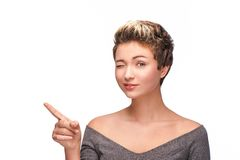 Young woman winking at camera Stock Photography