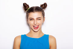 Young woman  winking and showing tongue Stock Photos