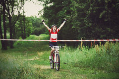 Young woman wins the race crossing finish line Stock Images