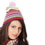 Young woman with winter cap. Close up of young woman with winter cap smiling at the camera isoalted on white background Stock Photography