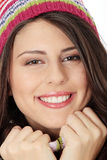 Young woman with winter cap. Close up of young woman with winter cap smiling at the camera isoalted on white background Stock Images