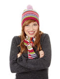 Young woman with winter cap. Close up of young woman with winter cap smiling at the camera isoalted on white background Royalty Free Stock Images