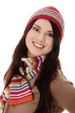 Young woman with winter cap. Close up of young woman with winter cap smiling at the camera isoalted on white background Royalty Free Stock Image