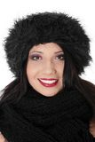 Young woman with winter cap. Close up of young woman with winter cap smiling at the camera isolated on white background Royalty Free Stock Photos