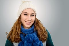 Young woman with a  winter cap. Pretty smiling young woman with a  winter cap Stock Images