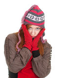 Young woman in winter cap and red mittens Stock Photography