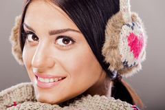 Young woman with winter clothes Stock Images