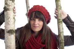 Young woman in winter clothes between birch trees Stock Images