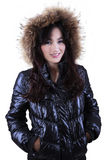 Young woman in winter clothes with fur hood Royalty Free Stock Image