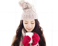 Young Woman in winter clothes having hot drink Royalty Free Stock Image