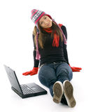 Young woman in winter clothes with laptop Royalty Free Stock Photography