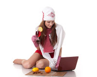 Young  woman in winter clothes with laptop. Stock Image