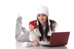 Young  woman in winter clothes with laptop Stock Photos