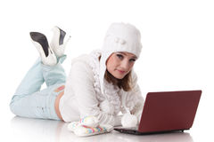Young  woman in winter clothes with laptop. Royalty Free Stock Photo