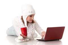 Young  woman in winter clothes with laptop. Royalty Free Stock Photography