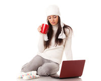 Young  woman in winter clothes with laptop. Stock Photos