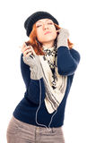 Young woman in winter clothes listening music Stock Photo