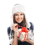 A young woman in winter clothes opening a present Royalty Free Stock Images