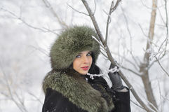 Young woman in winter clothes in the park Stock Images