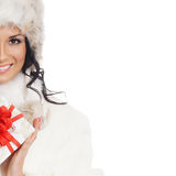 A young woman in winter clothes with a present Royalty Free Stock Image