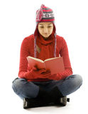 Young woman in winter clothes reading book Stock Photography