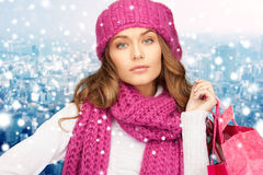 Young woman in winter clothes with shopping bags Royalty Free Stock Photos