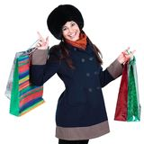 Young woman in winter clothes with shopping bags. Isolated on white background Stock Photography