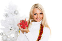 Young  woman in winter clothes with snowflake. Royalty Free Stock Image