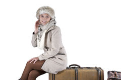 Young woman in winter clothes with suitcases Stock Images