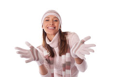 Young woman in winter clothes on a white Royalty Free Stock Photos
