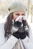 Young Woman in Winter Clothing Blowing Nose Stock Photos