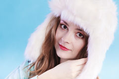 Young woman in winter clothing fur cap Royalty Free Stock Image