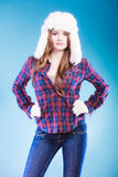Young woman in winter clothing fur cap Royalty Free Stock Photo