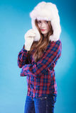 Young woman in winter clothing fur cap Royalty Free Stock Photography