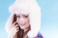 Young woman in winter clothing fur cap Stock Photography