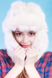 Young woman in winter clothing fur cap Stock Images