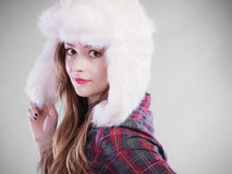 Young woman in winter clothing fur cap Stock Photos