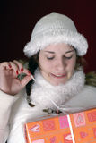 Young woman in winter clothing making funny faces Royalty Free Stock Images