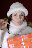 Young woman in winter clothing making funny faces Stock Images