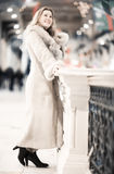 Young woman in winter clothing in trade center Royalty Free Stock Images