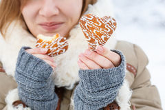 Young woman in winter coat and knitted grey mittens hold beautif Stock Image