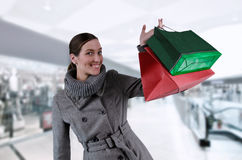 Shoping. Young woman in winter coat purchases in bags Stock Image