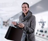Shoping. Young woman in winter coat purchases in bags Royalty Free Stock Image