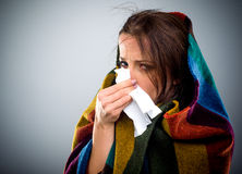 Young woman with a winter cold Royalty Free Stock Photo