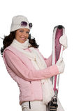 Young woman in winter fashion holding pink ski Royalty Free Stock Photos