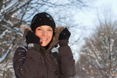 Young woman in winter forest Stock Photo