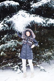 Young  woman in winter forest having fun with snow Stock Photos