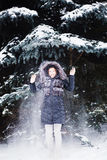 Young  woman in winter forest having fun with snow Royalty Free Stock Images