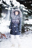 Young  woman in winter forest having fun with snow Stock Image