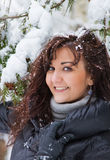Young woman in a winter forest Stock Image